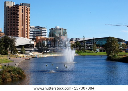 Torrens River, Adelaide city, Australia. As South Australia's seat of government and commercial centre, Adelaide is the site of many governmental and financial institutions. - stock photo