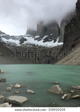 Torres del Paine and a lake in Chile - stock photo