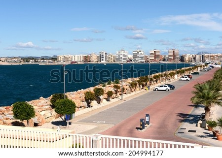 TORREVIEJA, SPAIN - MAY 6, 2012: Torrevieja is a Mediterranean city, with a privileged location and the unique climatic conditions. Is  as the ecological clean region of Europe. Embankment  in city.