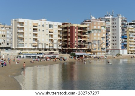 TORREVIEJA, SPAIN - OCTOBER 7, 2014:Torrevieja is a Mediterranean city, with a privileged location and the unique climatic conditions. The beach area of the city  in Torrevieja.