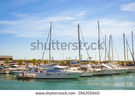 TORREVIEJA, SPAIN - SEPTEMBER 13, 2014: Puerto deportivo Marina Salinas. Yachts and boats parked at dock in Marina of Torrevieja. Bay with piers in centre of resort town. Valencia, Spain
