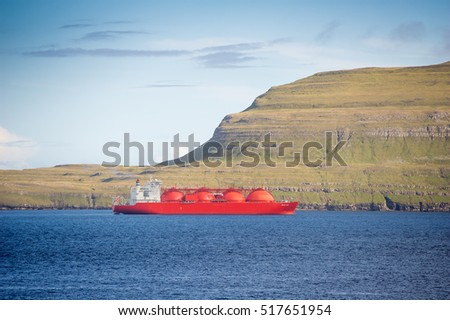 Torshavn, Faroe Islands - SEP 24, 2015: LNG (Liquefied Natural Gas) Tanker ARCTIC LADY at sea. A gas carrier or gas tanker is a ship designed to transport LPG, LNG or liquefied chemical gases in bulk.