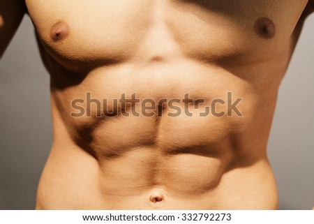 Torso of a well defined abdomen