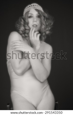 torso of a young woman in a white bikini - stock photo