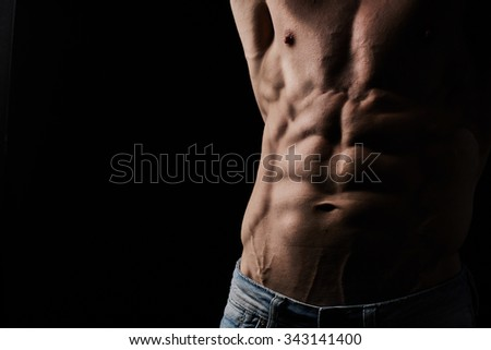 Torso of attractive muscular young man - stock photo
