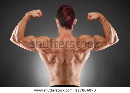 Torso of fit and muscular man - stock photo