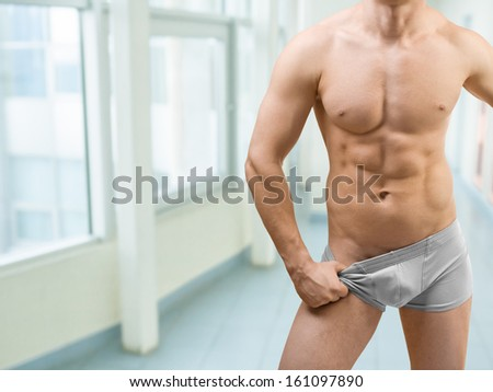 torso of muscular male - stock photo
