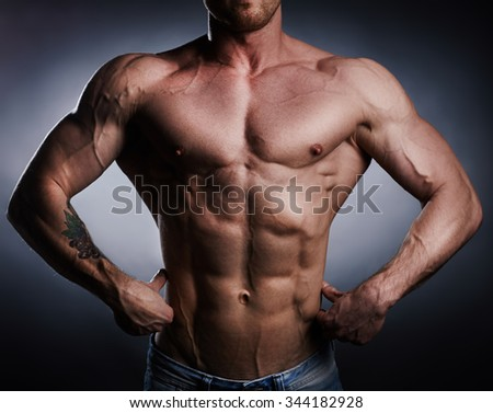 Torso of strong athlete - stock photo