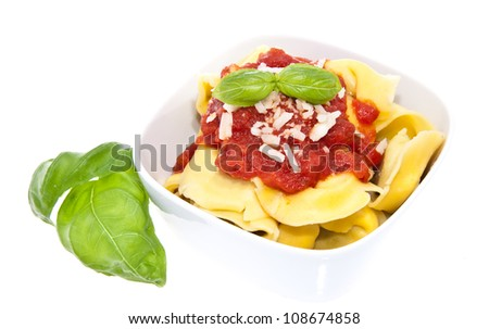 Tortellini with tomato sauce in a bowl isolated on white