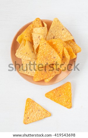 Tortilla chip , a snack food made from corn tortillas - stock photo