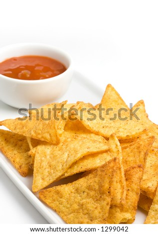 Tortilla chips and a cup of mexican chili sauce