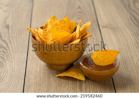 tortilla chips and tomato dip in a bowl - stock photo