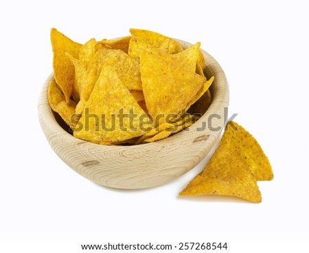 tortilla chips in a wooden bowl isolated on white