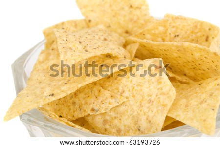 tortilla chips isolated on white background in vase closeup. - stock photo