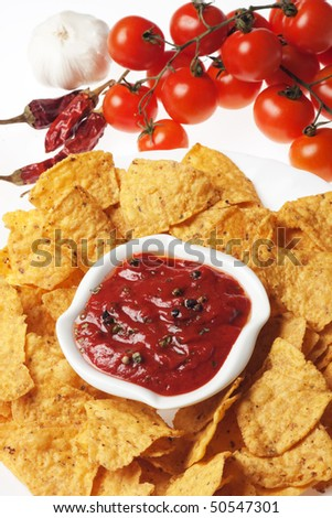 Tortilla chips with hot mexican salsa dip