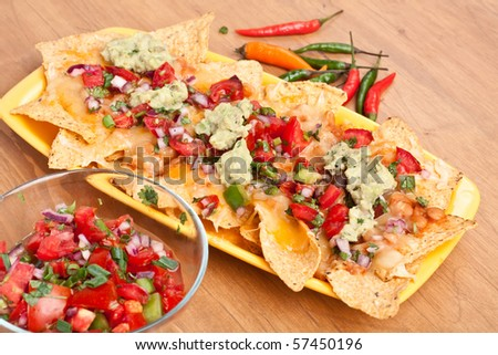 Tortilla chips with hot salsa and  guacamole - stock photo