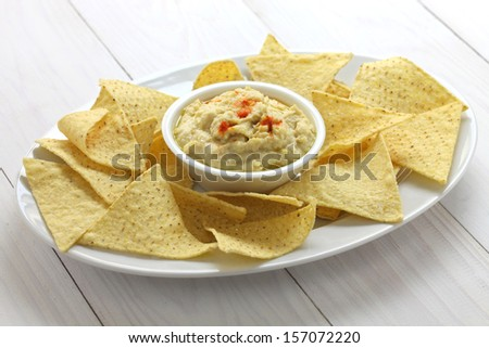 tortilla chips with hummus dip for super bowl