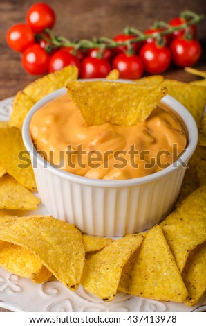 Tortilla chips with two dips, chilli hot and cheese dip