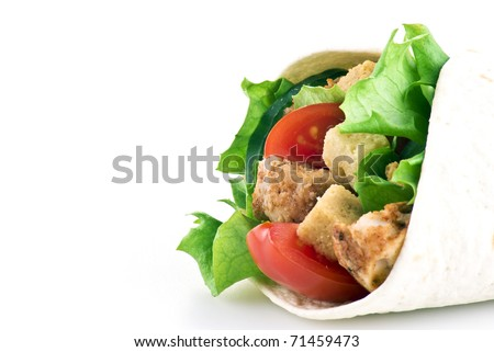 Tortilla filled with lettuce chicken tomatoes and cucumber