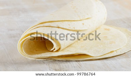 Tortilla on a wooden table - stock photo