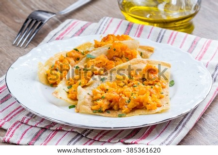 Tortilla, pancake, crepe stuffed with potatoes, red lentils, tasty dish - stock photo