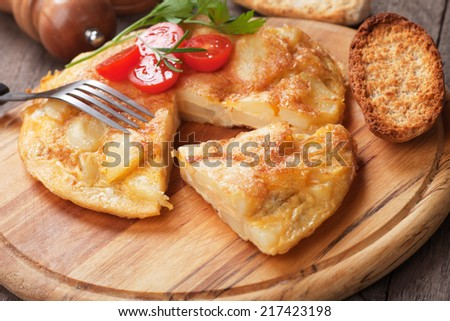 Tortilla, spanish omelet with potato and scrambled eggs - stock photo