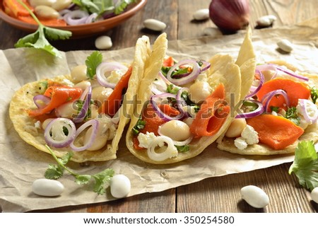Tortilla, tacos with vegetables: pumpkin, white beans, goat cheese and onions - stock photo