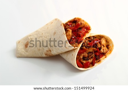 Tortilla with chicken and bell pepper. Isolated on a white background. - stock photo