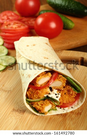 Tortilla with Chicken Nuggets - stock photo