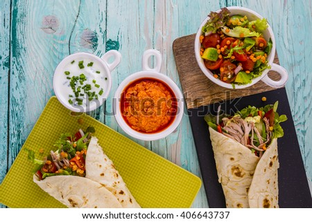 Tortilla with pulled pork, fresh vegetables