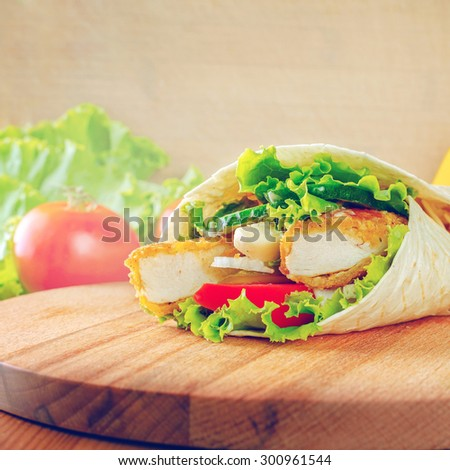 Tortilla wrap with chicken  - stock photo