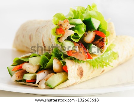 tortilla wraps with chicken  and fresh vegetables - stock photo