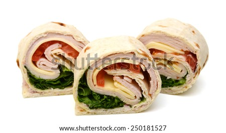 tortilla wraps with meat and vegetables on white