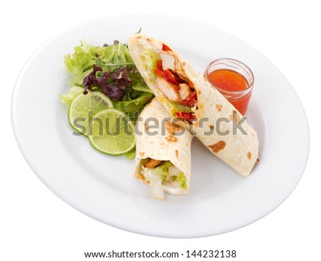 Tortillas are commonly prepared with meat to make dishes such as tacos, burritos, and enchiladas. - stock photo