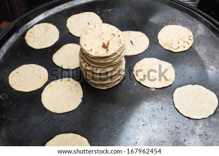 Tortillas cooked in a market, Guatemala, Central America. - stock photo