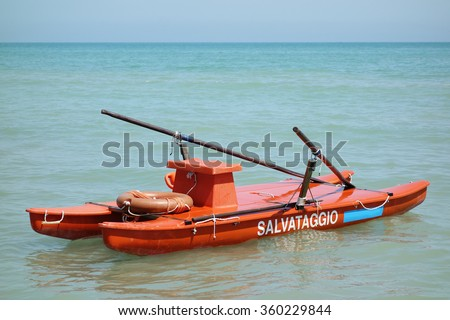 Tortoreto, Italy: August 2014: Twin-hulled rowboat at the sea offshore in Tortoreto, Italy