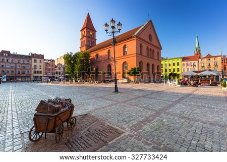 TORUN, POLAND - AUG 9, 2015: Architecture of historical Trinity church in Torun, Poland. Torun is one of the oldest cities in Poland and the birthplace of the astronomer Nicolaus Copernicus. - stock photo