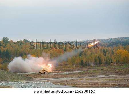 TOS-1A system from fighting and resupply vehicles attacks target. Uralvagonzavod production. Russia - stock photo
