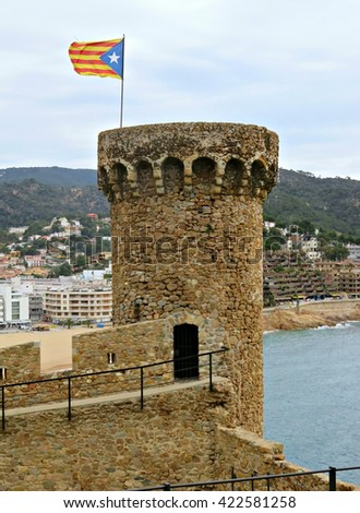 TOSSA DE MAR, SPAIN - MAY 6, 2016: View of Tossa de Mar and its medieval castle which was built during the 12th century.