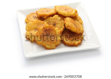 tostones, patacones, fried green plantain banana chips on white background - stock photo
