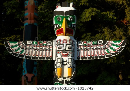 Totem Pole: Eagle wings. More with keyword group14c