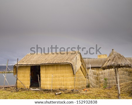 Totora Reed hut on the Uros floating islands of Lake Titicaca in Peru - stock photo