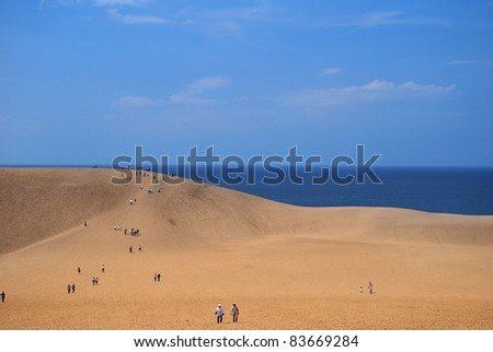 TOTTORI PREFECTUR, JAPAN - SEPTEMBER 2: Huge desert sand dunes taken on September 2, 2008 in Tottori prefecture, Japan. The dunes are the only large dune system (over 30 square km) in Japan. - stock photo