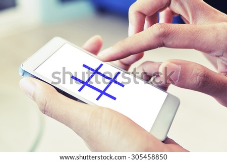 touch hashtag sign on smart phone