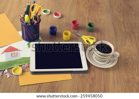 Touch pad and coffe cup on a wooden background - stock photo