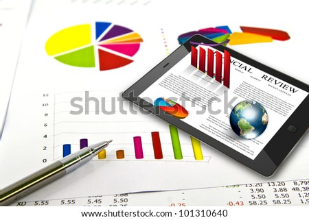 Touch pad and financial Graphs  (Elements of this image furnished by NASA) - stock photo