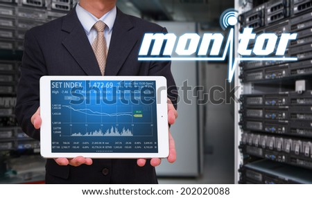 Touch pad and graph monitor system  - stock photo
