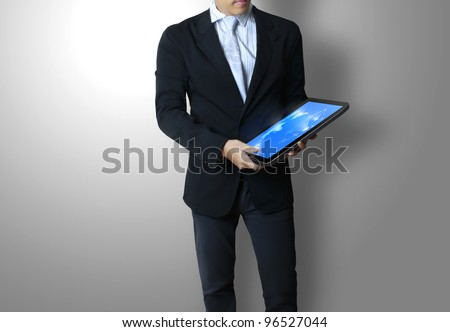 touch pad concept in hands - stock photo