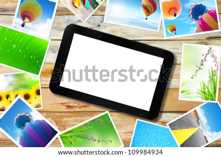 touch pad PC with streaming images on wood - stock photo