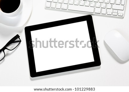 touch pad tablet gadget is in the office of a businessman